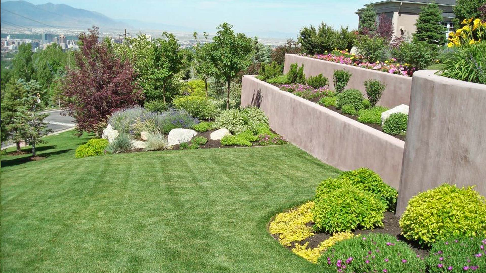 Lawn mowing stripes and meticulously maintained landscaping at a property located in Draper.