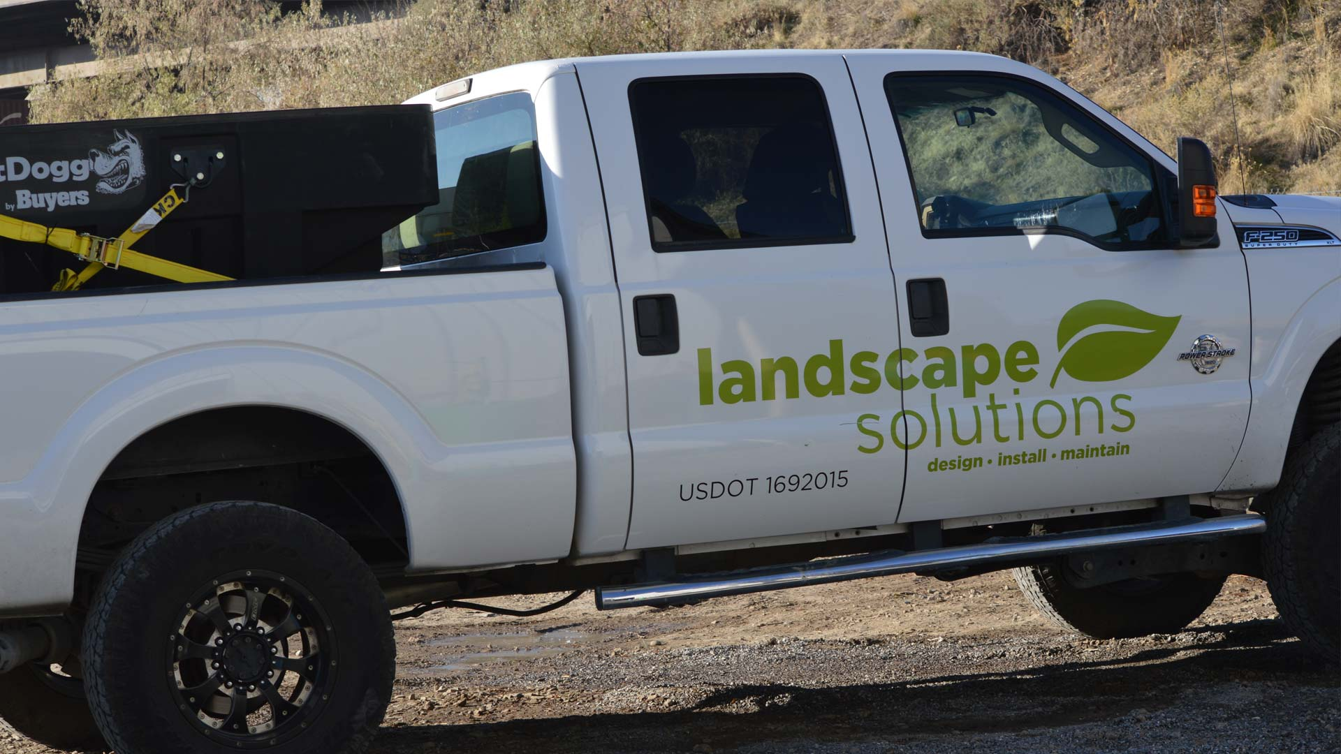 Our work truck with our contact information signage.