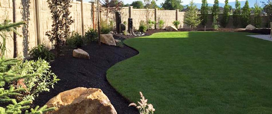 The backyard of a home in Draper that we regularly maintain the lawn and all landscaping beds.