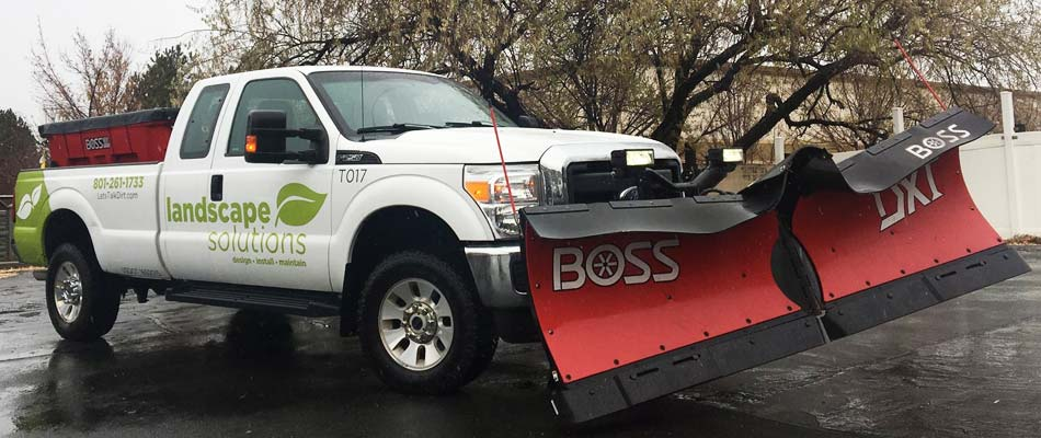 Our work truck in South Jordan with a Boss snow plow attached to the front.