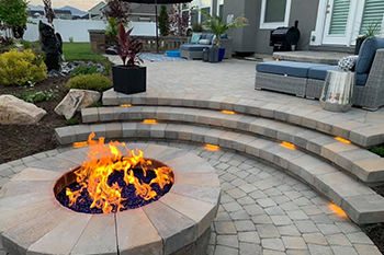 A custom patio and fire pit that our team installed in Draper, UT.