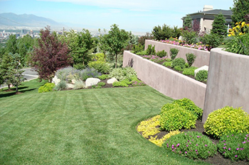 Salt Lake City home with beautiful landscaping that we maintain on a regular basis.