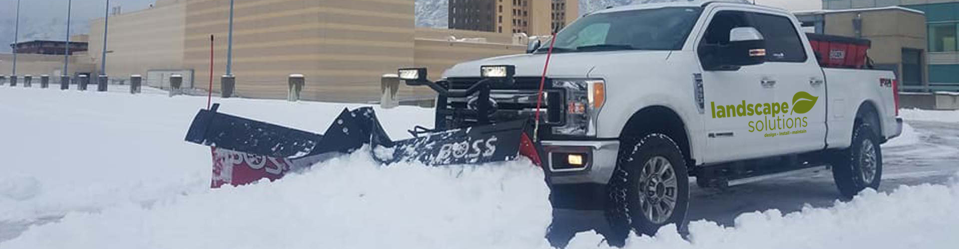 Our snow plow clearing a commercial parking lot in Salt Lake City.